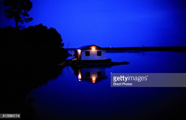 Floating house in Amazon rainforest at night Brazil