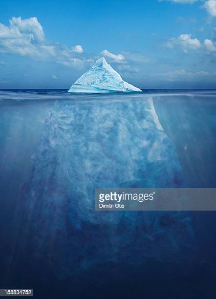 floating iceberg, showing its size under water - berg stock pictures, royalty-free photos & images