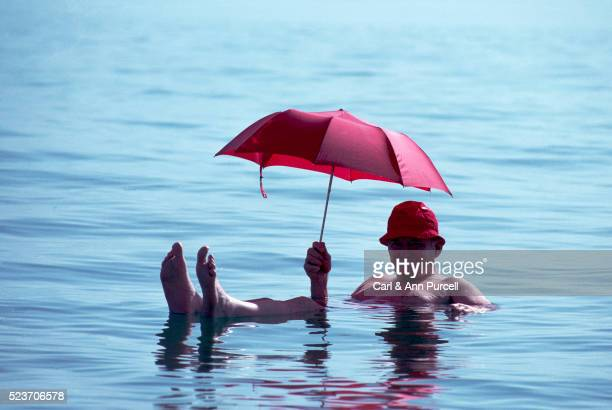 floating in the dead sea - dead sea stock pictures, royalty-free photos & images