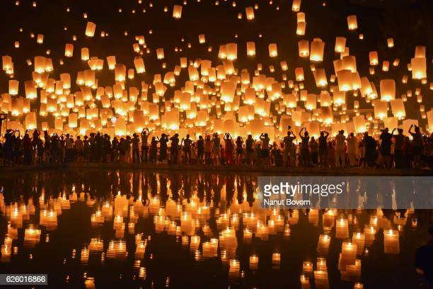 floating lanterns in thailand : reflection - chiang mai province stock photos and pictures