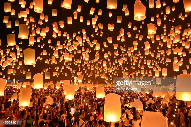 floating lanterns : yi peng in thailand - lantern stock photos and pictures