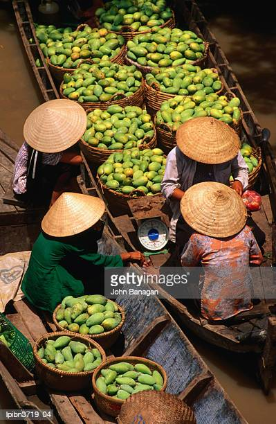 floating market along the mekong delta, an giang, vietnam, south-east asia - floating market stock photos and pictures