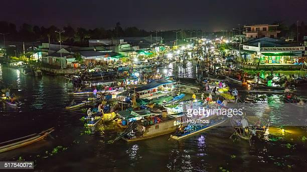 floating market nightlife scene wetland vietnam - floating market stock photos and pictures