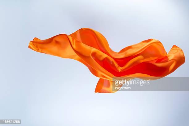 floating orange silk on a bright background - 優美 ストックフォトと画像