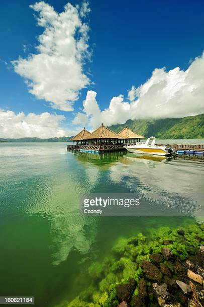 floating pagoda on a lake - lake batur stock photos and pictures