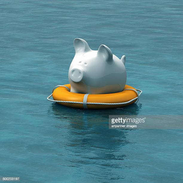 a floating piggy bank in a lifebuoy - bailout stock pictures, royalty-free photos & images