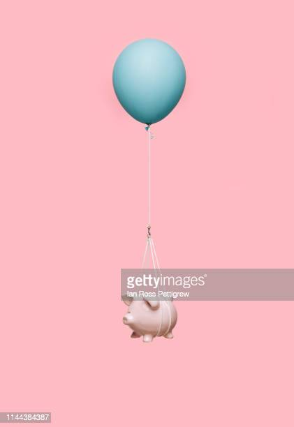 floating piggybank - balloon stock pictures, royalty-free photos & images