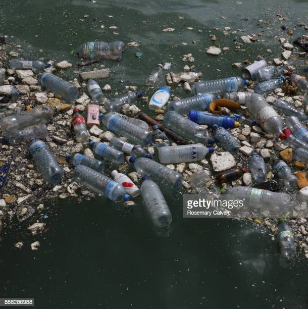 bottles other plastic waste floating indian