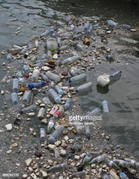 plastic bottles polystyrene other waste floating