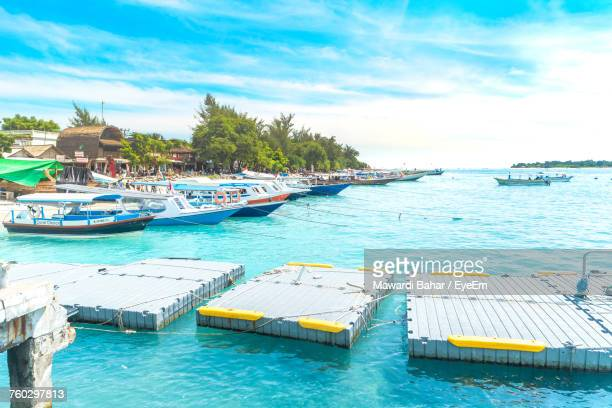 floating platforms on turquoise sea at gili islands - gili trawangan stock photos and pictures