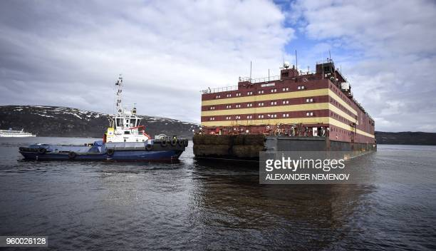 Floating power unit Akademik Lomonosov is being towed to Atomflot moorage of the Russian northern port city of Murmansk on May 19 2018 Akademik...