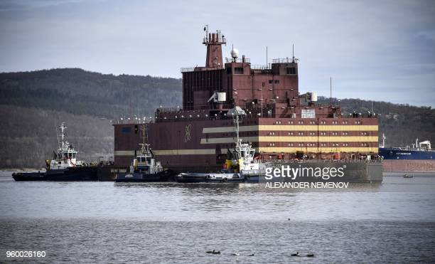 TOPSHOT Floating power unit Akademik Lomonosov is being towed to Atomflot moorage of the Russian northern port city of Murmansk on May 19 2018...