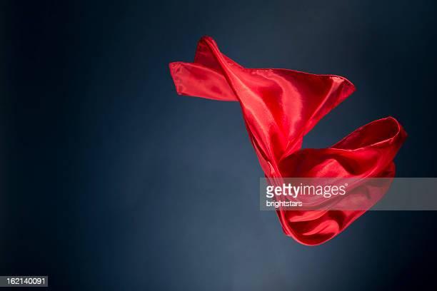 floating red satin on a dark blue background - soie photos et images de collection