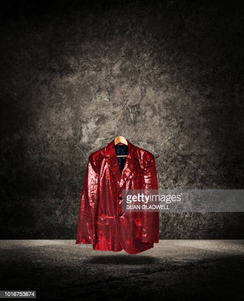 floating red sequin cabaret jacket on hanger - blazer jacket stock pictures, royalty-free photos & images
