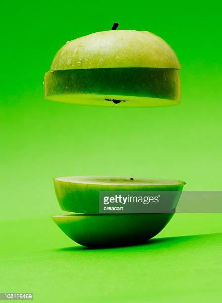 Floating, Sliced Appled on Green Background