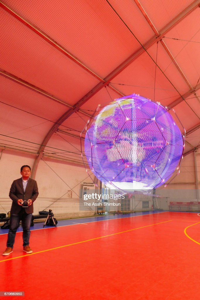 A floating sphere spaped drone display, developed by mobile phone giant NTT DoCoMo, is unveiled on April 20, 2017 in Tokyo, Japan. The drone, four-roter multicopter equipped lines of light-emitting diode (LED) lights, is used as omnidirectional display by rotating the LED lines with brinking them. NTT DoCoMo aims to develop into practical use next year, mainly as advert or guidance display for spectators in stadiums and concert halls.
