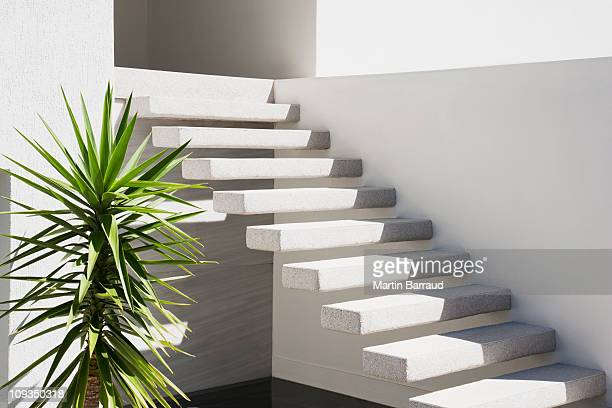 Floating staircase on exterior of house