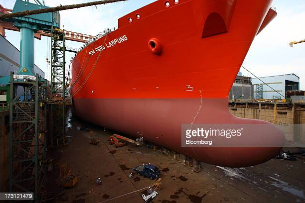A Floating Storage Regasification Unit liquefied natural gas vessel sits under construction in the dry dock at the Hyundai Heavy Industries Co...