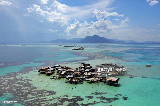 floating village on a coral reef in celebes sea - village stock pictures, royalty-free photos & images