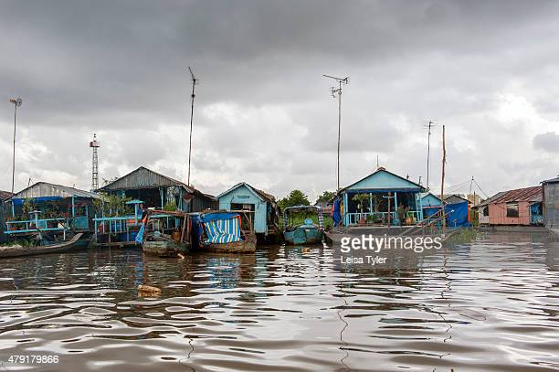 A floating village where fish are raised in suspended metal nets under people's houses at Chao Doc a town on the Mekong Delta in Vietnam Around 11...