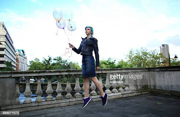 floating with balloons - anatoleya stock pictures, royalty-free photos & images