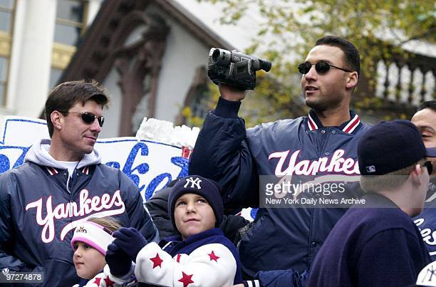 Floats carrying the World Champion New York Yankees move up Broadway through the Canyon of Heroes during a ticker tape parade to celebrate the...