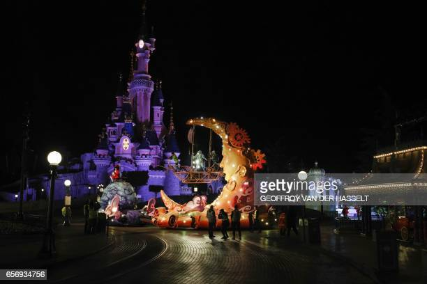 Floats drive past the Sleeping Beauty Castle during a night rehearsal of the Disney Stars on Parade on March 20 2017 ahead of celebrations marking...