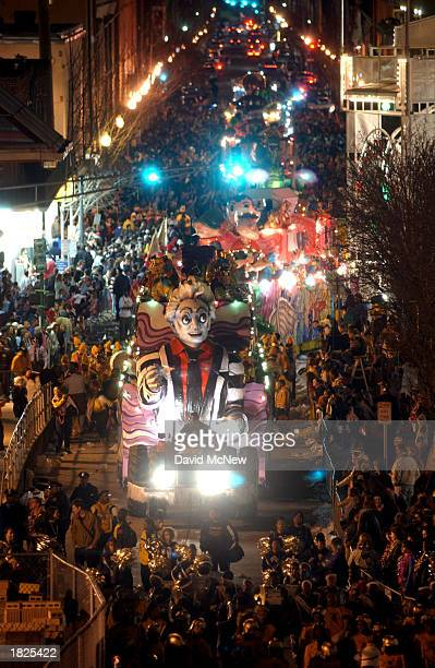 Floats move down the street during the Bacchus parade as Mardi Gras goers countdown to Fat Tuesday on March 2 2003 in New Orleans Louisiana Fat...
