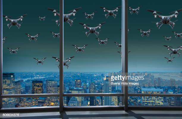 flock of drones over a city