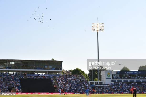 Flock of pigeons fly over the ground during the international Twenty20 cricket match between England and India at Sophia Gardens in Cardiff, south...
