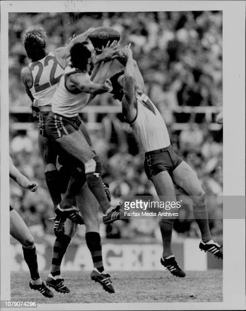 A Flock of Swans from left Craig Holden Mark Browning and Ian Roberts combine to ground a Bomber at the SCG yesterday July 13 1986