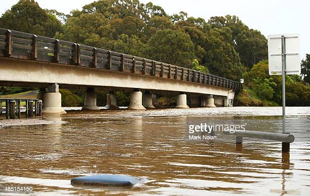 A flodded Minumurra River passes under bridges on August 25 2015 in Minumurra Australia Residents downstreamm of the Jerra dam which feeds into the...