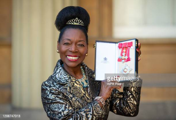 Floella Benjamin poses with her Dame Commander medal, after being awarded her damehood by the Prince of Wales at an investiture ceremony at...