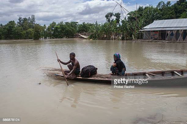 JAMALPUR MYMENSINGH BANGLADESH A flood affected family searching a dry place to take shelter According to the Bangladesh Disaster Management Bureau...