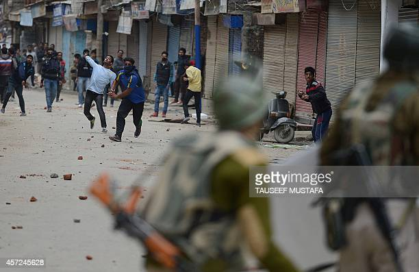 Flood affected Kashmiri residents clash with Indian police during a protest against the state government in Srinagar on October 15 2014 Kashmir was...