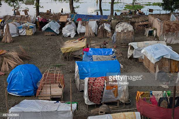 SATKHIRA KHULNA BANGLADESH Flood affected people take shelters in the temporarily built house made of bamboo and plastic sheet Satkhira Bangladesh...