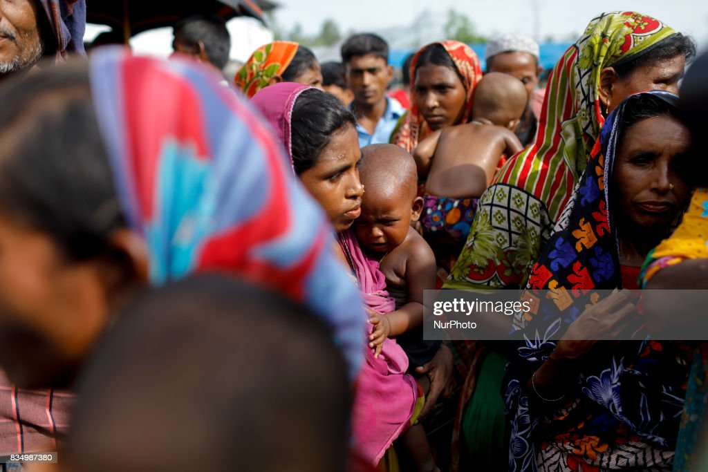 Flood affected women gather to receive relief from a local rulling party MP at Jamtola, Sariakandi, Bogra, Bangladesh 17 August 2017. According to authorities, floods caused by heavy rainfall lashing Bangladesh during the past week have left at least 56 people dead. Affected people are waiting to get more relief as they are in shortage of food and drinking water in the shelter centers.