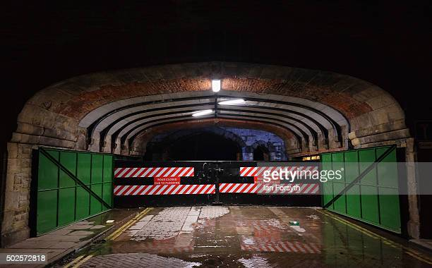 A flood barrier is in place along the banks of the River Ouse on December 27 2015 in York England Heavy rain over the Christmas period has caused...