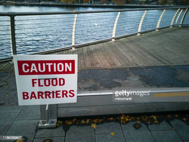 flood barriers up along river - construction barrier stock pictures, royalty-free photos & images