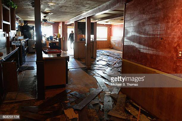 Flood damage is seen in Joe Boccardi's restaurant on January 2 2016 in Eureka Missouri Days after the record crest of the Meremac River commercial...
