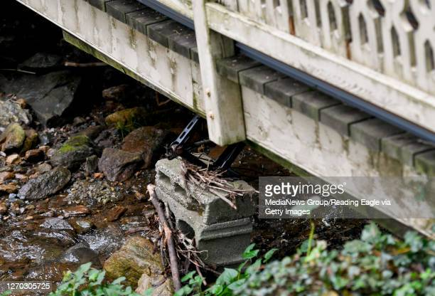 Flood damage to a small bridge over a stream behind a house along Park Lane. The supports for the bridge have been washed out. In Lower Alsace...