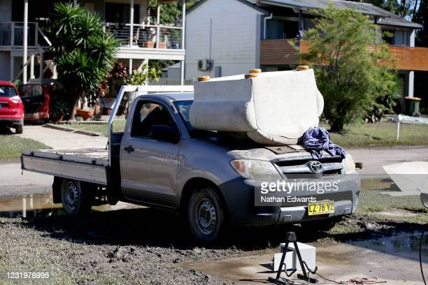 Flood damaged dry outside homes in the North Shore community of Port Macquarie on March 28, 2021 in Port Macquarie, Australia. Residents of the small...