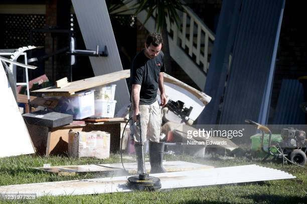 Flood damaged items lay outside homes during the cleanup of the North Shore community of Port Macquarie on March 28, 2021 in Port Macquarie,...