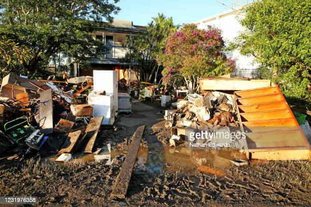 Flood damaged items lay outside homes in the North Shore community of Port Macquarie on March 28, 2021 in Port Macquarie, Australia. Residents of the...