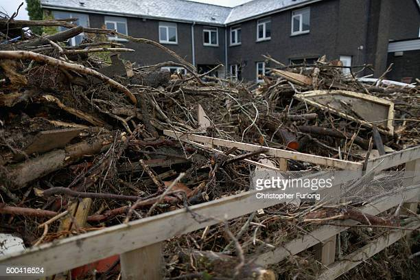 Flood debris piles up in front of homes on December 8 2015 in Keswick United Kingdom Engineers are working to reconnect thousands of homes left...