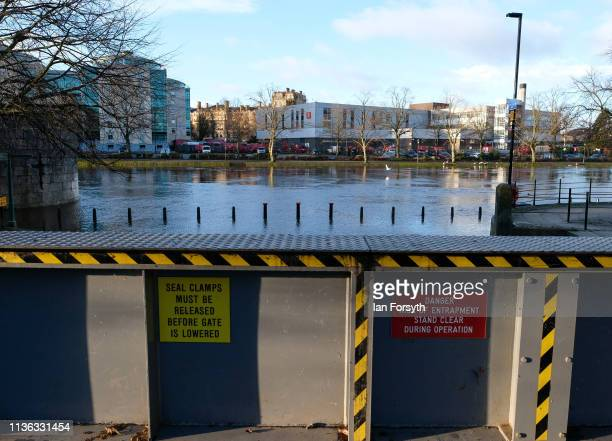 Flood defences are closed as river waters rise and spill over the banks of the River Ouse on March 17 2019 in York England Heavy rain caused flooding...