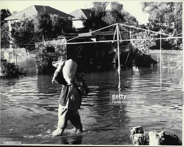 Flood disaster at Redfern this morning.Volunteers with bags of sands for Levy's. July 25, 1988. .