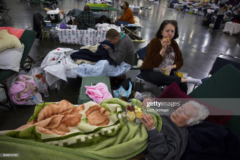 Flood evacuee Dorothy Baker, 89, has a snack with her daughter Bonnie Baker, 64, at the George Brown Convention Center which has been turned into a shelter run by the American Red Cross to house victims of the high water from Hurricane Harvey on August 28, 2017 in Houston, Texas. The Baker's home in the Meyerland neighborhood was underwater. Harvey, which made landfall north of Corpus Christi late Friday evening, is expected to dump upwards to 40 inches of rain in areas of Texas over the next couple of days.