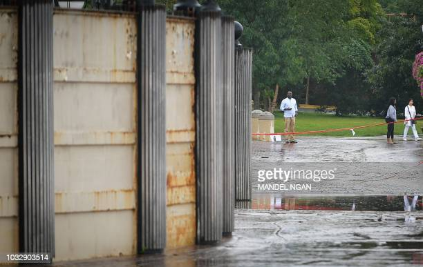 Flood gates are closed in the Georgetown waterfront in Washington, DC on September 13, 2018 as Hurricane Florence approaches the southeast coast of...