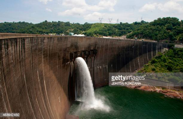 Flood gates on the Kariba Dam wall between Zimbabwe and Zambia open ceremonially on February 20 2015 after the two neighbors signed $294 million in...